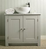 Bathroom vanity cabinet with Carrara Marble top and countertop sink, painted in Modernist White.