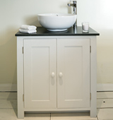 Bathroom vanity cabinet with Honed Black Granite top and countertop sink, painted in Bone White.