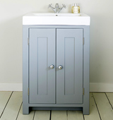 Bathroom vanity cabinet with an Overlay Sink top and traditional tap, painted in Plumbago.