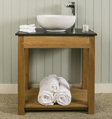 Bathroom washstand in Solid Oak with Honed Black Granite top and countertop sink.