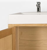 A 1200mm bathroom cabinet in solid oak with double overlay sink and contemporary taps (single adjustable shelf included).